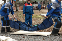 Rescue team with dummy during the emergency training at Narvskaya HPP Stock Photos
