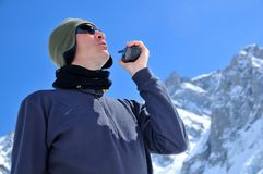 Rescue team member in mountains with walkie talkie Royalty Free Stock Photography