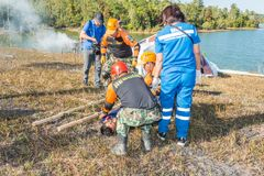 Rescue team preaparing to carry injured passenger to hospital in Royalty Free Stock Photography