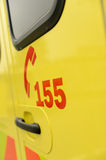 Rescue team's telephone number yellow ambulance car Stock Photography