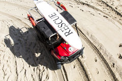 Rescue team on their way to the lifeguard towers Royalty Free Stock Photography