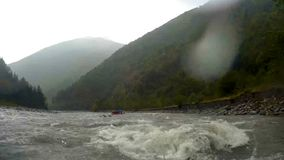 Rescue team trying to swim to tourists group who got trapped during rafting. Stock footage stock video