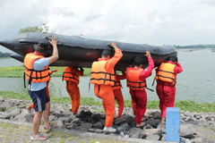 Rescue. Tim search and rescue take exercise with rubber boat on cengklik lake or reservoir, Ngemplak, Boyolali, Central Java, Indonesia Royalty Free Stock Photo