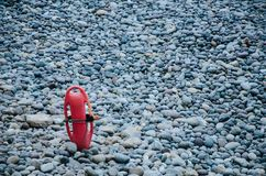 Rescue torpedo. Nailed on the stones on the beach Royalty Free Stock Photography