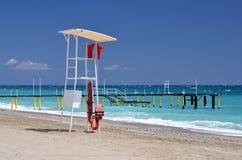 Rescue tower on beach. Ocean Stock Photos