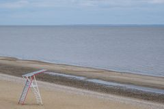 Rescue tower on the shore. Deserted beach. Minimalism concept royalty free stock image
