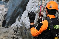 Rescue training rock climbing and abseiling to help victims stock image