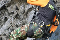 Rescue training rock climbing and abseiling to help victims royalty free stock photography