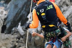 Rescue training rock climbing and abseiling to help victims stock photos