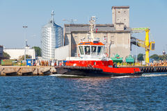 Rescue tug. Red marine boat rescue operations and anti fire works Stock Image