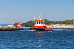 Rescue tug. Red marine boat rescue operations and anti fire works Royalty Free Stock Photography