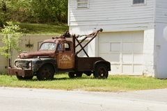 Retired wrecker. A rescue vehicle from the middle of last century, retired here in Homer, Georgia Royalty Free Stock Photo