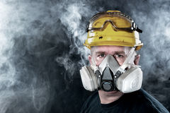 Rescue worker. A rescue worker wears a respirator in a smokey, toxic atmosphere. Image show the importance of protection readiness and safety stock images