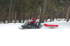 Rescue worker on snowmobile Royalty Free Stock Image