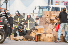 Rescue workers help a person after jumping from a height Stock Photos