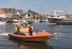 Rescue workers at lifeboat in harbor Urk, the Netherlands Royalty Free Stock Photos