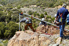 Rescue Workers practicing a Rescue Drill on Ledge of Mountain Royalty Free Stock Photos
