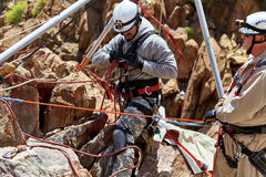 Rescue Workers practicing a Rescue Drill on Ledge of Mountain Royalty Free Stock Photography