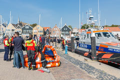 Rescue workers showing rescue equipment in Dutch harbor of Urk Royalty Free Stock Images