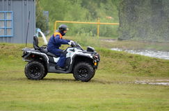Rescuer on the ATV at the training ground of the Noginsk rescue center of the Ministry of Emergency Situations during the Internat Royalty Free Stock Photography