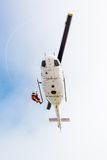 Rescuer descending from helicopter Royalty Free Stock Photos