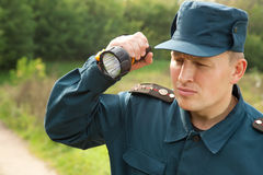 Rescuer with flashlight royalty free stock photography