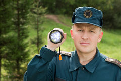 Rescuer with flashlight Stock Photo