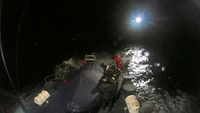 Rescuer of a helicopter of Salvamento Maritimo training in the night. Helicopter of the Spanish Maritime Rescue Team  Salvamento Maritimo training over the deck stock video footage