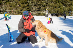 Rescuer and his service dog Royalty Free Stock Image