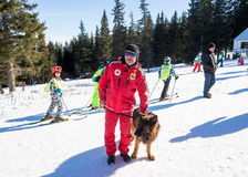Rescuer and his service dog Royalty Free Stock Photo