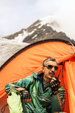 The rescuer in mountains talks on handheld transceiver Stock Photography