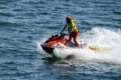Rescuer riding waverunner in Alicante coast in Spain. Royalty Free Stock Images