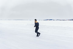 Rescuer running on the winter road. Shot with the motion blur Royalty Free Stock Photo