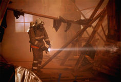 Rescuer search victims on fire Royalty Free Stock Photo