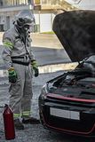 Rescuer at smoking car Stock Images