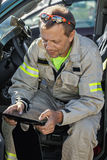 Rescuer with tablet Royalty Free Stock Image