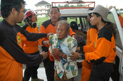 Rescuer. To give relief to the victims of the earthquake in Yogyakarta, Indonesia Stock Images