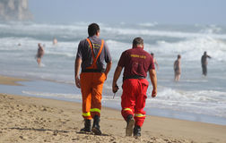 Rescuers on the beach. Stock Photo