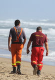 Rescuers on the beach. Stock Image