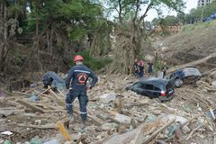 Rescuers examine debris as a result of mudslides Royalty Free Stock Photos