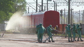 Rescuers Extinguishing Fire At Railway Station stock footage