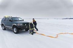 Rescuers fastens orange rope Stock Photos