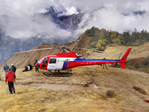 Rescuers Helicopter Action Himalayas. Rescuers in action at high altitudes of the Himalayas Stock Images