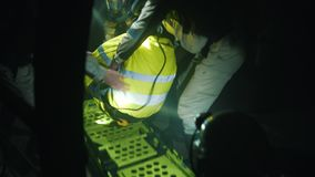 Rescuers lay a miner on a stretcher