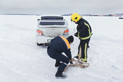 Rescuers prepare towing car Royalty Free Stock Images