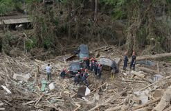Rescuers pulled the car with trash after mudslides Royalty Free Stock Photos