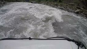 Rescuers rushing through troubled wild river to save rafting team in trouble. Stock footage stock video