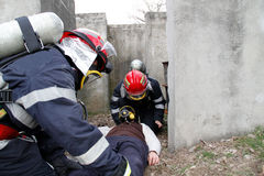 Rescuers and victim Stock Images