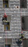 Rescuers during the workouts climbing the building Royalty Free Stock Image