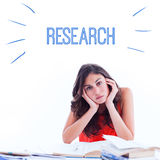 Research against stressed student at desk Stock Photos